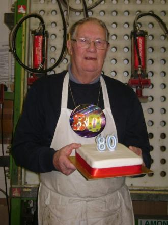 Ron Taylor celebrates his 80th birthday at work in Foots Cray.