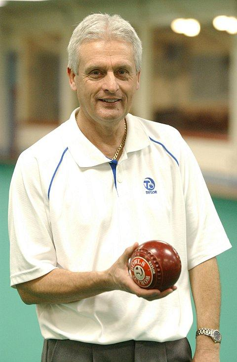 Bowling champion Andy Thomson playing at Cyphers Indoor Bowling club, Beckenham,