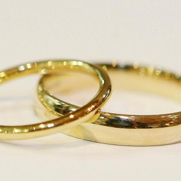 A solicitor has been jailed over a scam marriages scheme said to be worth 20 million pounds