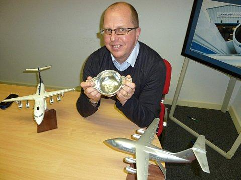 Martin Darling, Technical Director, Avalon Aero, holds the BAE  Systems Trophy for 'best performing niche market maintenance organisation for 2012'.