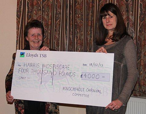 Sandra Rumbold (right), Relationship Fundraiser for HarrishospisCare, receiving the cheque from Gill Storey (left), chair of Committee.