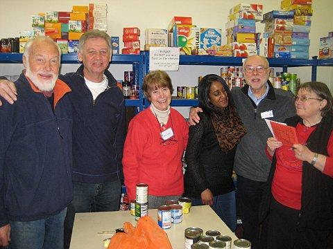 Volunteers in the store room of Lewisham Food Bank