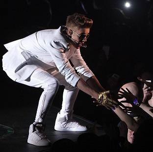 "Justin Bieber left the stage mid-song during his O2 concert after complaining of being ""light of breath"","