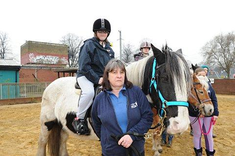 Emily Campbell, 12, riding pony Arthur with volunteer Carol Kendall