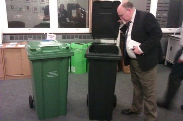 Dartford Council leader Jeremy Kite admires one of the new slimline bins next to the larger one it will replace.