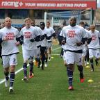 Millwall footballers warm up in Save Lewisham Hospital t-shirts, picture courtesy of Keith Gillard