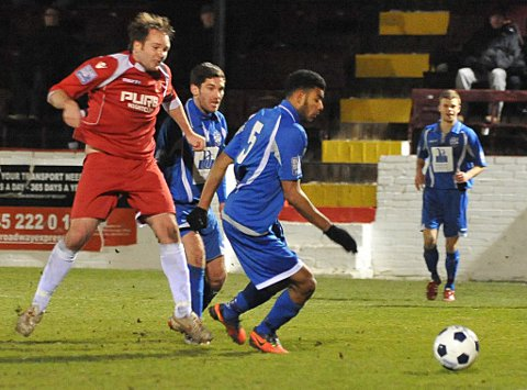Lee Clarke slots a shot past Anthony Sinclair-Furlonge to score Welling's third goal