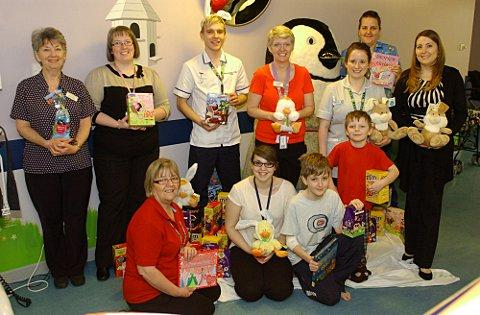 Nico staff members presenting their donations at Darent Valley Hospital.