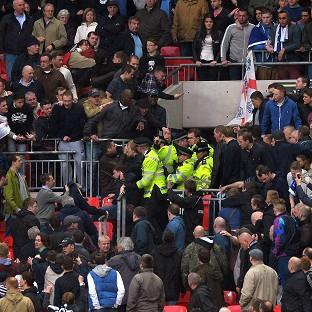 Millwall police hat theft arrest after Wembley disorder