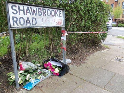 News Shopper: Floral tributes to Shaun Hayes have been left at the edge of the police cordon