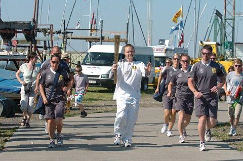 The flame arrives in the borough at Erith Yacht Club.