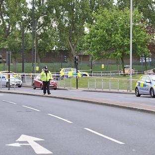 News Shopper: Police close to the scene where a man was killed in John Wilson Street, Woolwich