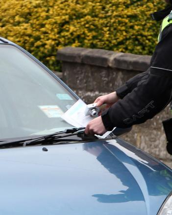 Council parking fines could be reduced over 'cash cow' fears