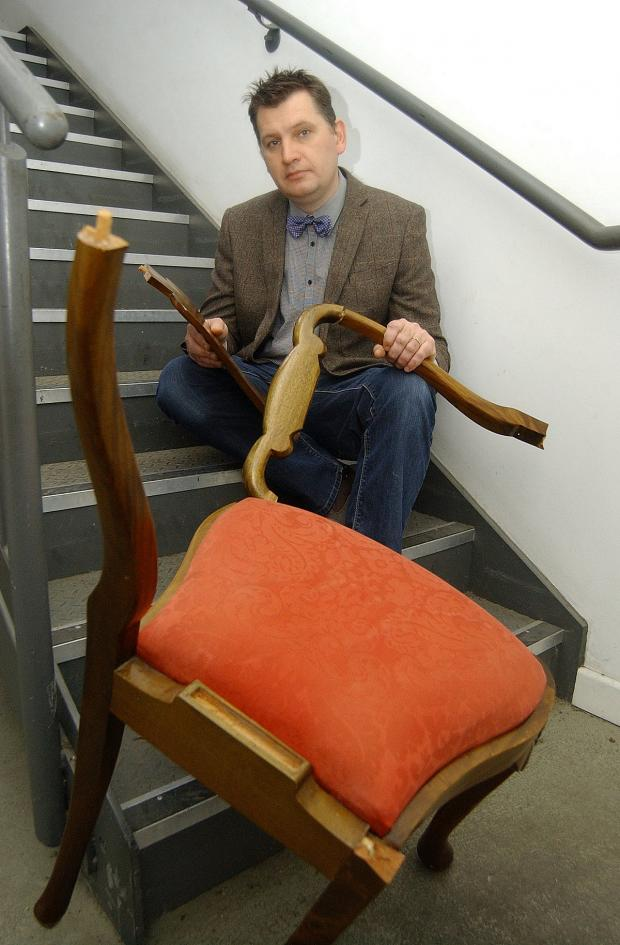 News Shopper: Horror: This chair was thrown at Mr Smith-Gore by an attention-seeking phantom