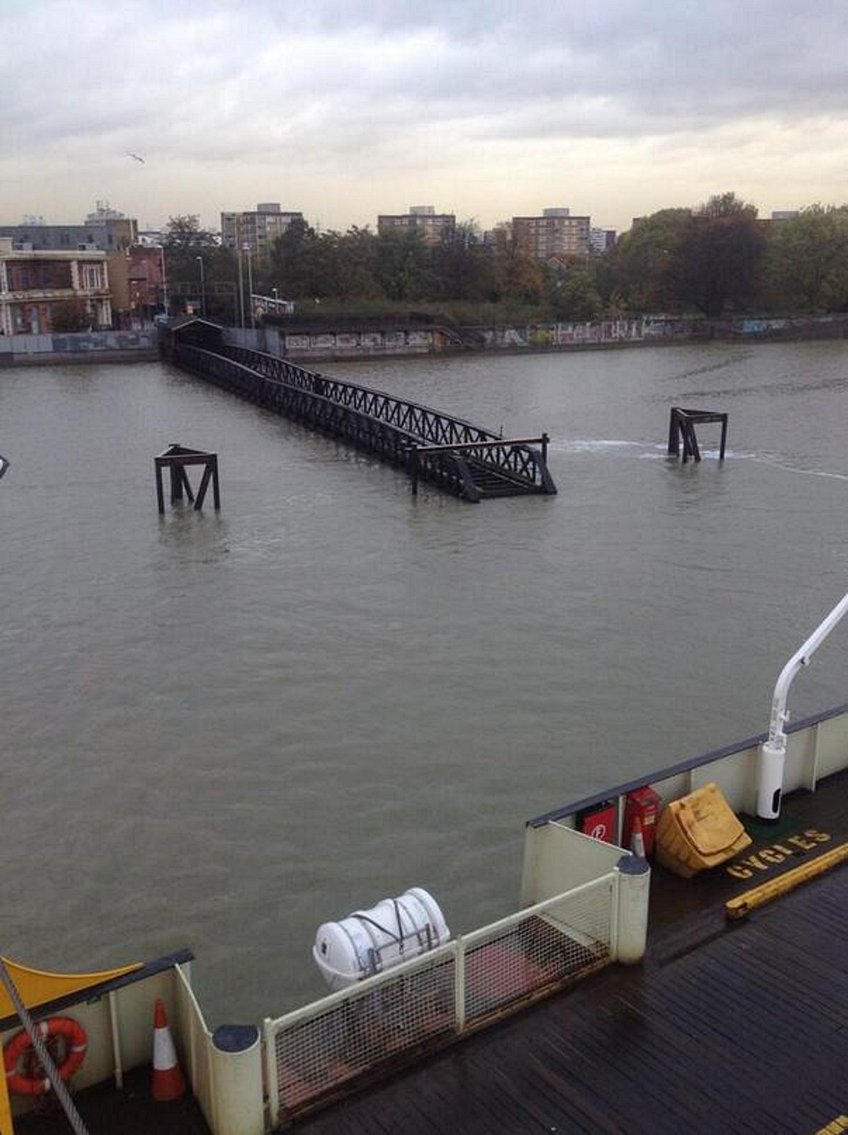 PICTURED: Thames high tide floods roads and almost swallows Woolwich Pier