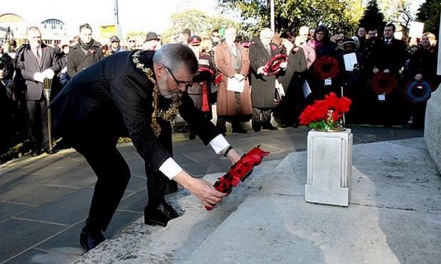 News Shopper: Mayor of Lewisham Sir Steve Bullock laid the first wreath at the war memorial on Lewisham High Stree