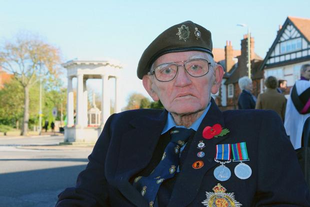 News Shopper: William Dyer, an ex National Serviceman who served with the Royal Army Service Corps, at Mottingham's war memorial