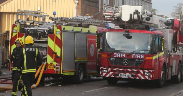 Greenwich woman rescued from flat fire after neighbour smells burning