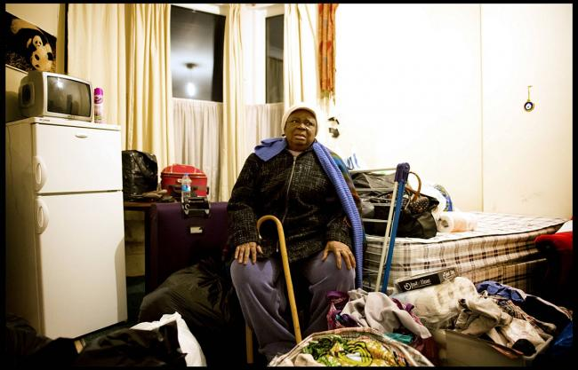 Beatrice Denedo with her belongings as she is about to be kicked out of her Catford flat, picture courtesy of Kelvin Bruce