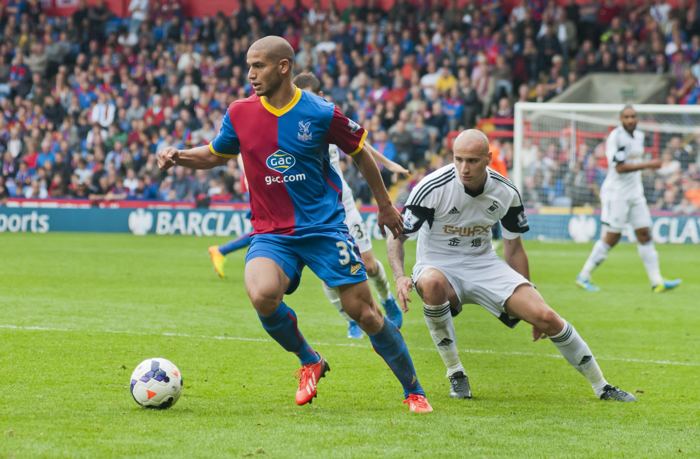Guedioura in action against Swansea.