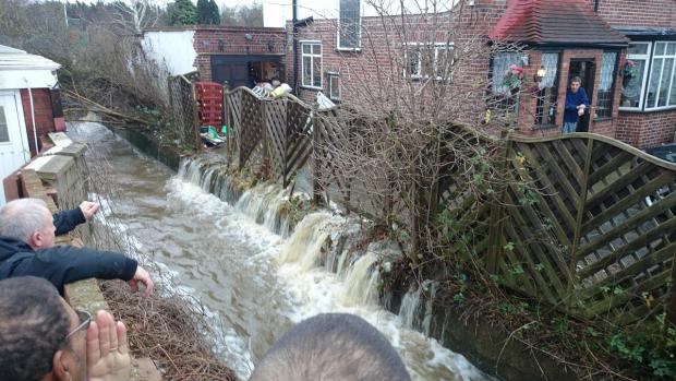 News Shopper: Residents of Westhorne Avenue, Eltham, watch the floods