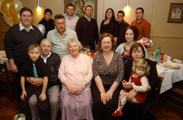 Mr and Mrs Neal celebrating their 60th wedding anniversary with their family
