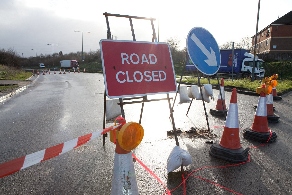 Frustrated drivers move signs from flooded Bob Dunn Way in Dartford