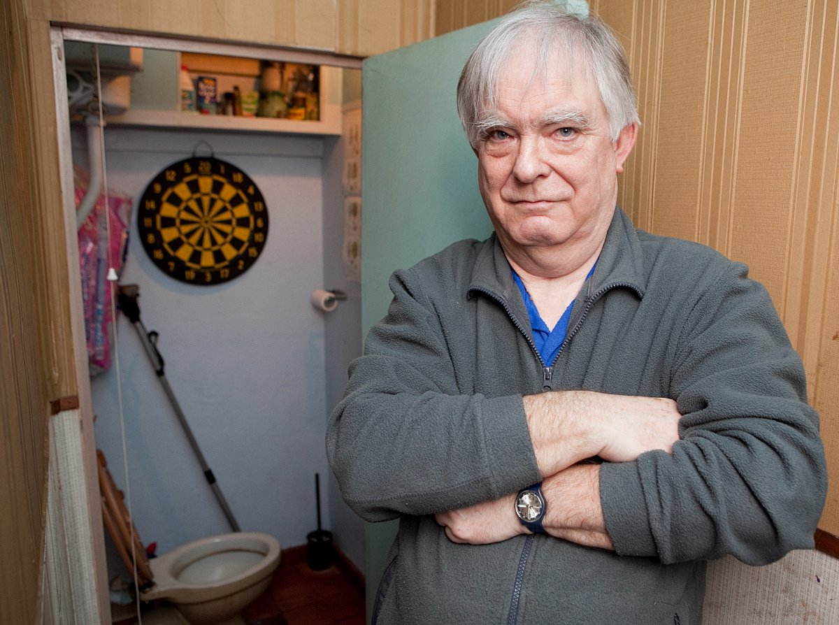Colin Eldridge and the downstairs toilet where burglar Aragorn Dudley was found by police.