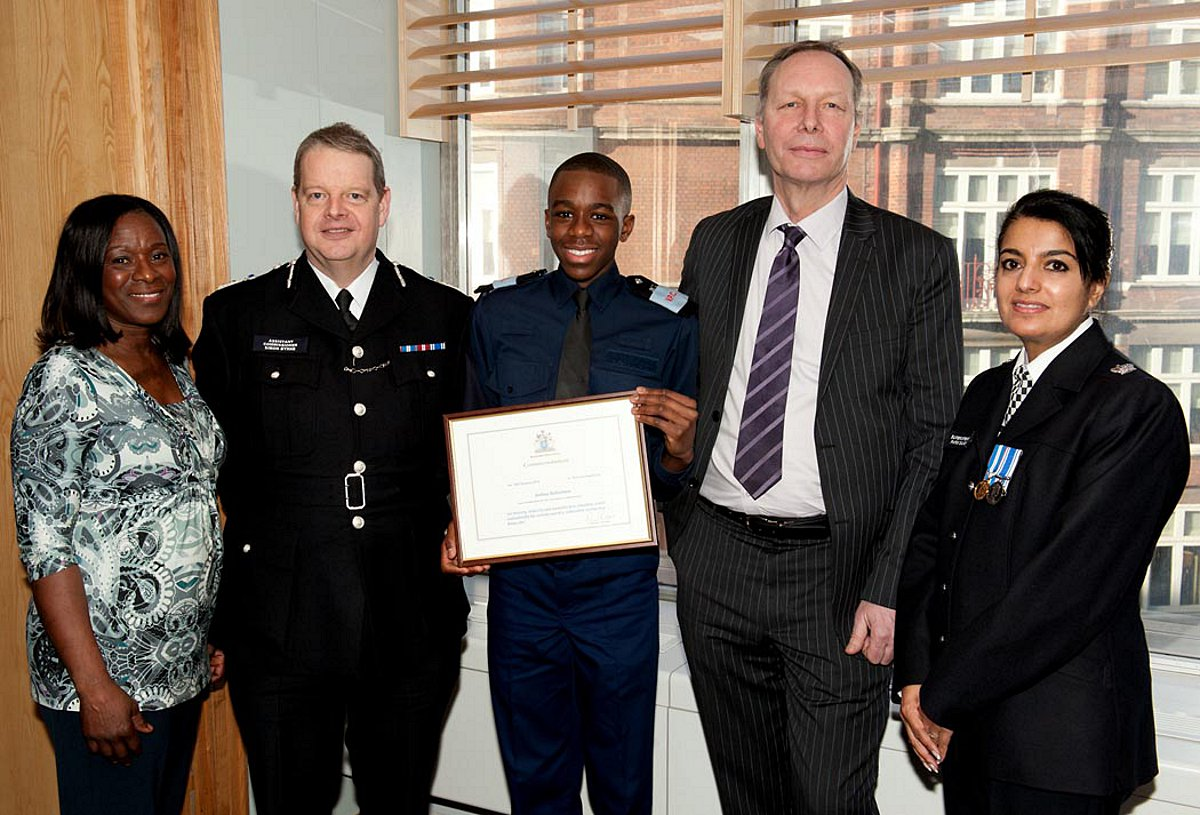 Pictured L-R: Joshua's mum Judith Robertson; Assistant Commissioner Simon Byrne; volunteer police cadet Joshua Robertson; deputy head teacher of St Paul's Academy Tony Ring; Superintendent Parm Sandhu