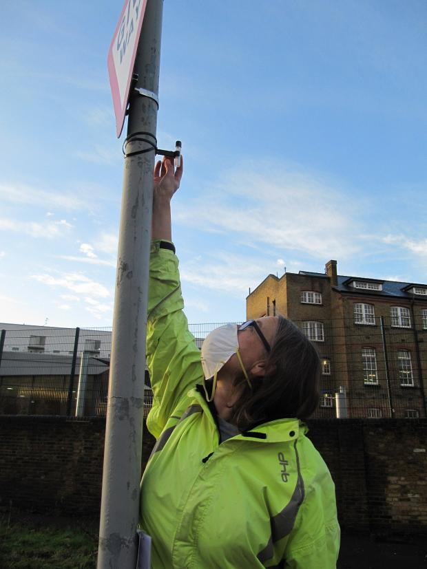 News Shopper: Don't Dump on Deptford campaigner Helena Russell installs a diffusion tube outside St Joseph's Catholic Primary School