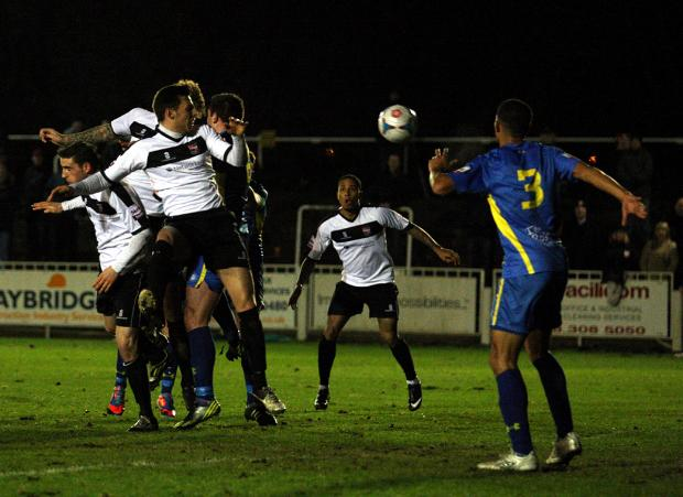 News Shopper: Rob Swaine (hidden) opens the scoring for Bromley. PICTURES BY EDMUND BOYDEN.
