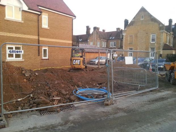 News Shopper: A digger has now filled in the trench into which the man is said to have fallen.