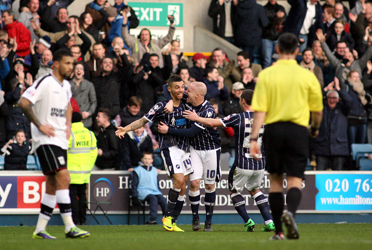 News Shopper: Fredericks is congratulated after opening the scoring