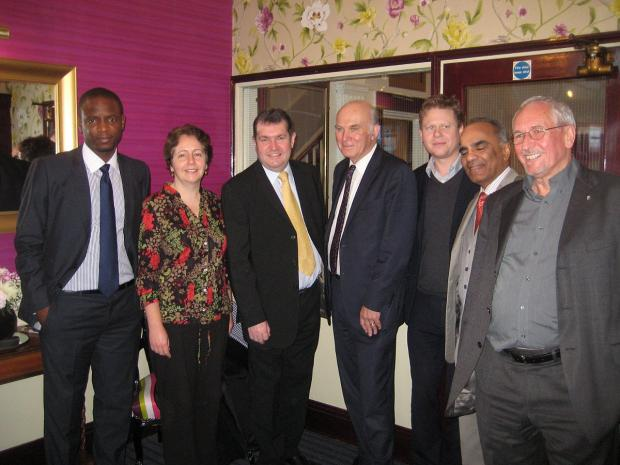 News Shopper: Vince Cable pictured with Lewisham Lim Dem leader Cllr Chris Maines and other representatives at the Blackheath breakfast meeting