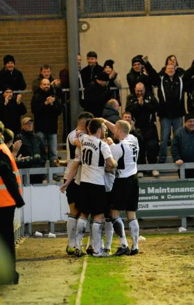 Danny Harris is congratulated after putting Dartford 3-2 in front