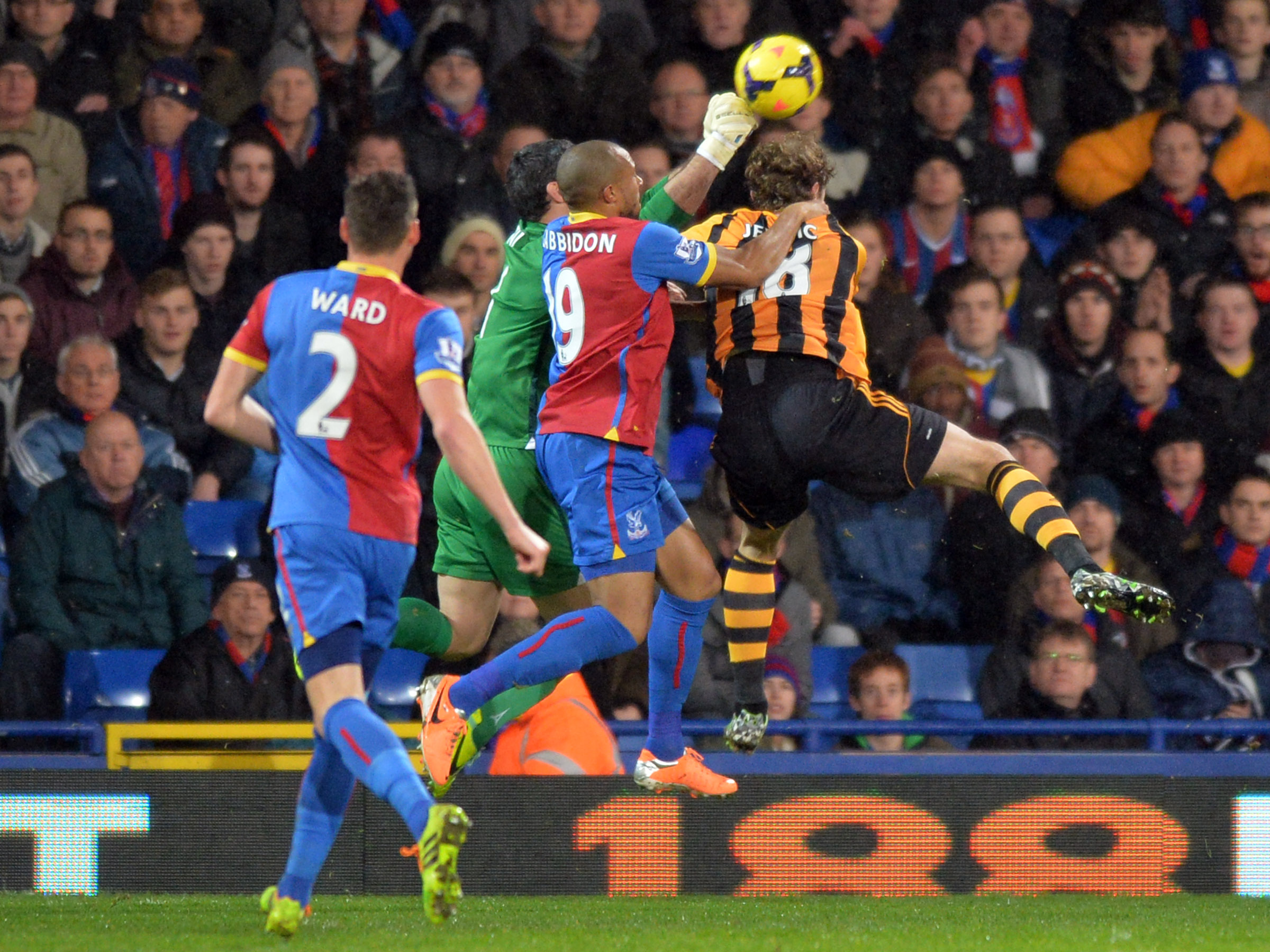 Julian Speroni punches clear under pressure from Nikica Jelavic. PICTURES BY KEITH GILLARD.