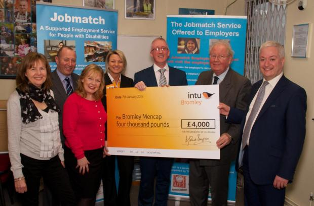 Patrick Burgess MBE, chairman of Intu, gives Mencap Bromley's chief executive Eddie Lynch a cheque for £4,000