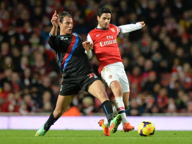 News Shopper: Marouane Chamakh battles it out with Mikel Arteta yesterday. PICTURES BY KEITH GILLARD.