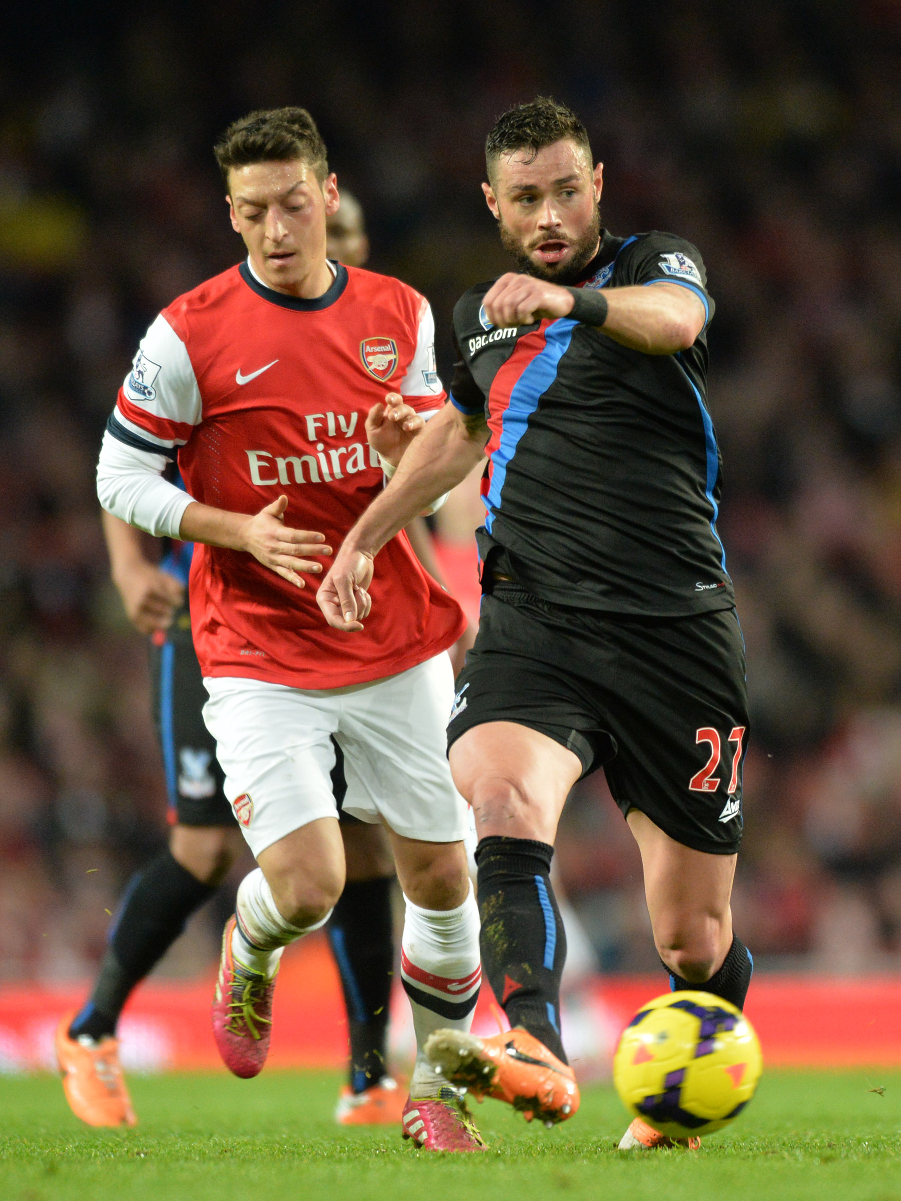 News Shopper: The Eagles defender gets the better of German star Mesut Ozil at the Emirates. PICTURE BY KEITH GILLARD.