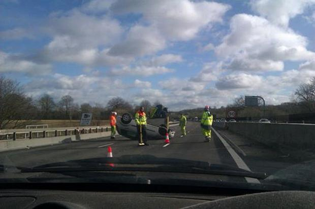The hatchback was left overturned in the middle lane of the M25.