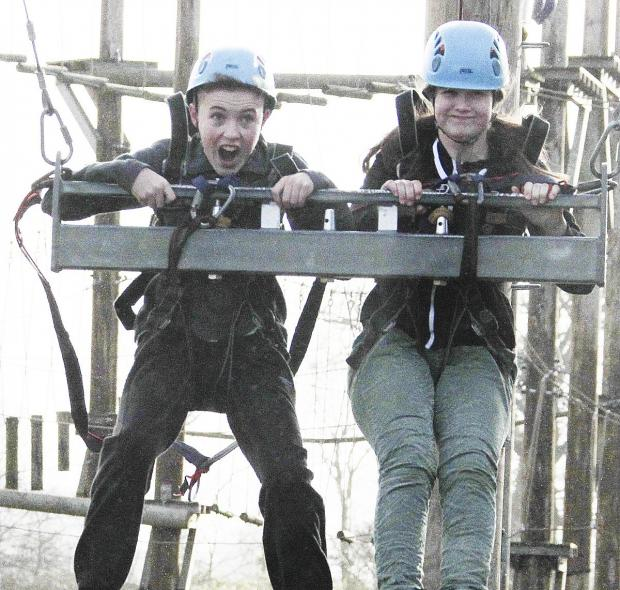 Jake Watson and Constance Treveil, both 13, on the 3G swing.