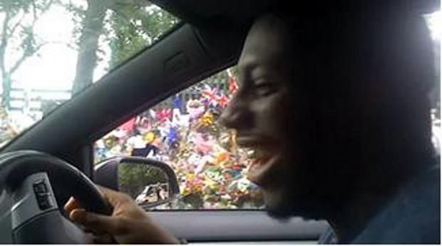 News Shopper: Sick: Barnes laughs as he drives past the tributes to Lee Rigby