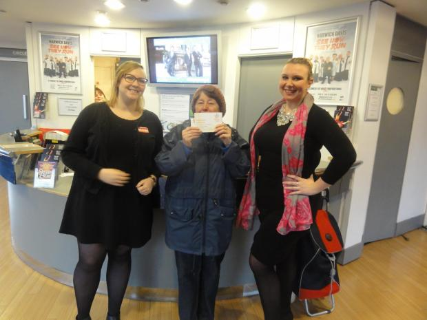 Gloria (centre) with box office staff Holly (left) and Emma