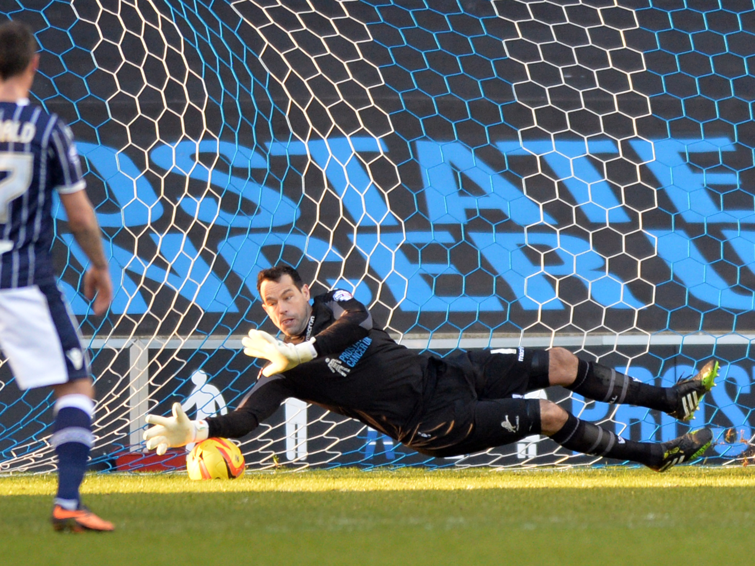 News Shopper: David Forde makes the vital penalty stop