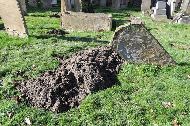News Shopper: Council employees have been working hard to fill in the sunken graves.