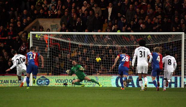 Julian Speroni is beaten by Robin van Persie's penalty. PICTURE BY EDMUND BOYDEN.