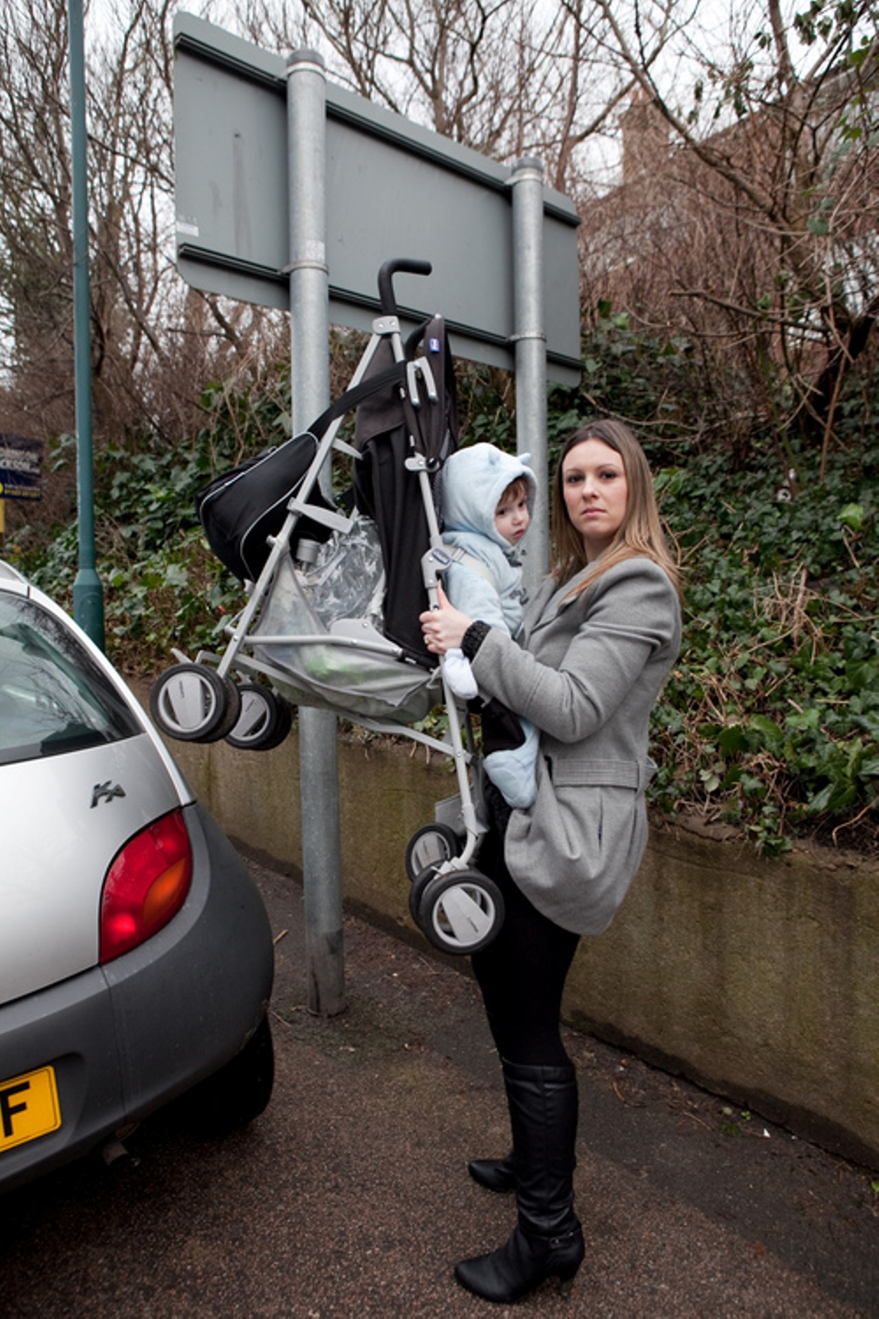Angry mums carrying buggies over car bonnets outside Dartford school