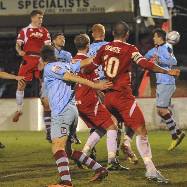 News Shopper: Alfie Mawson heads in Welling's second goal through a crowded area. PICTURES BY DAVE BUDDEN.