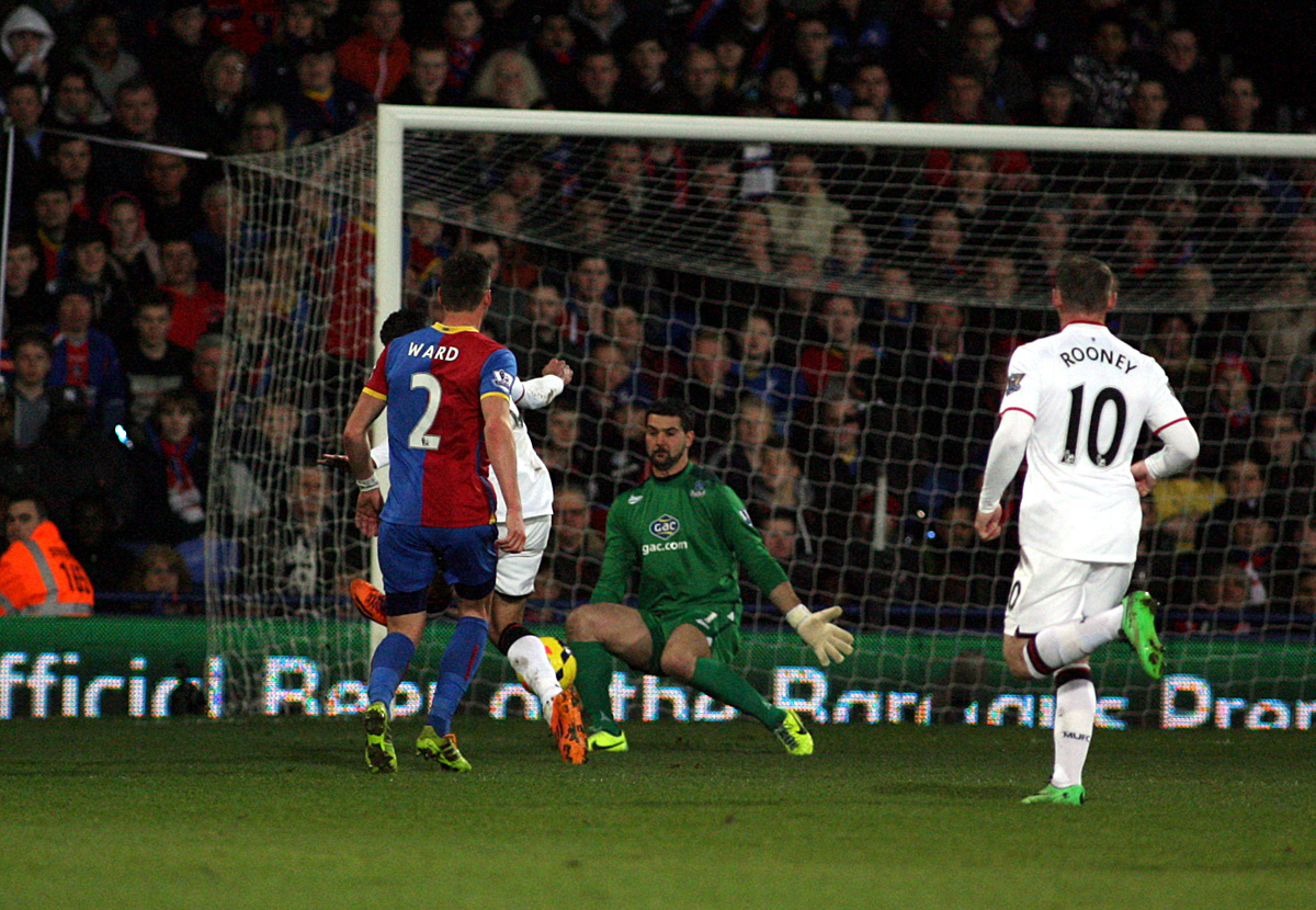 News Shopper: Julian Speroni saves from Robin van Persie