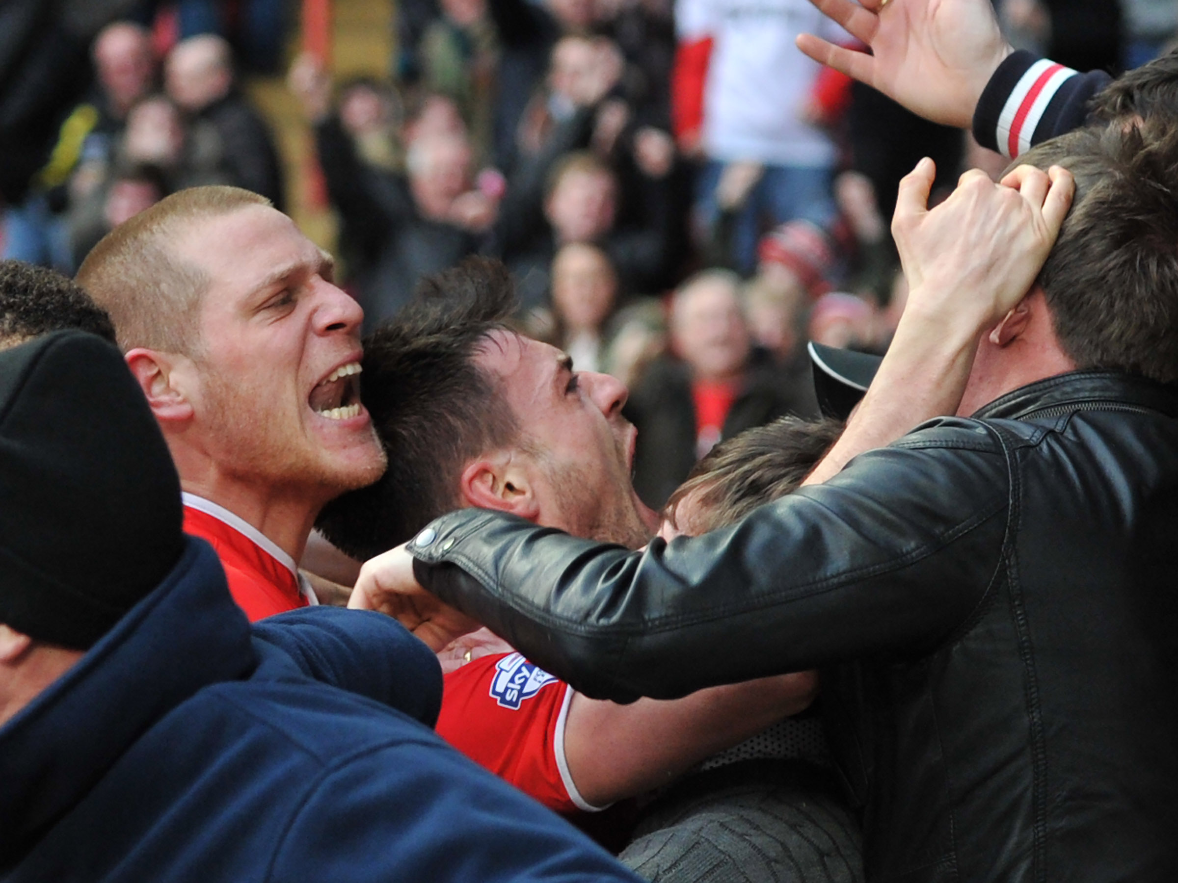 Johnnie Jackson joins the fans to celebrate his late, late winner against QPR on Saturday. KEITH GILLARD.